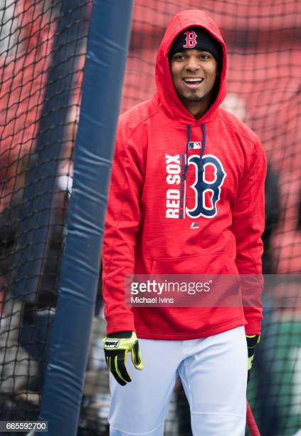 Xander Bogaerts of the Boston Red Sox steps out of the cage during batting practice before a game against the Pittsburgh Pirates at Fenway Park on...