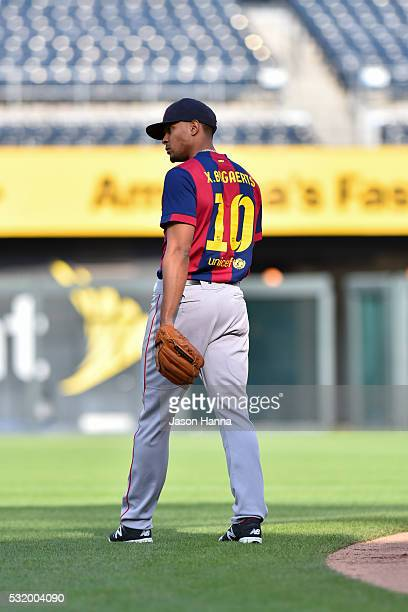 Xander Bogaerts of the Boston Red Sox takes prepares to take ground balls in his custom FC Barcelona jersey before the game against the Kansas City...