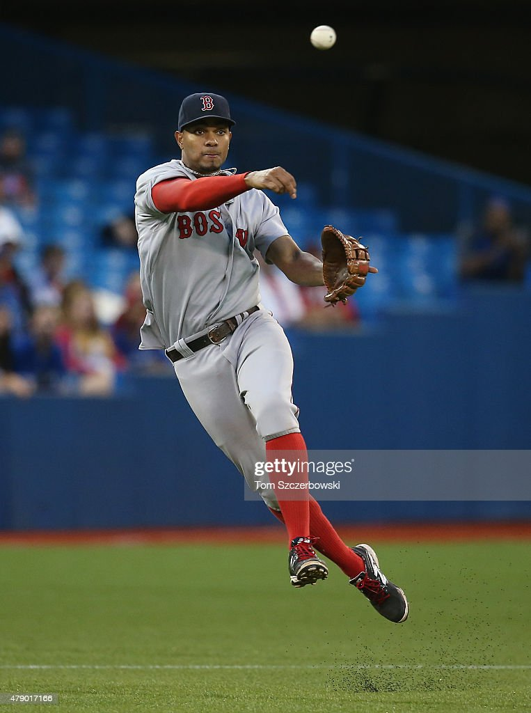 Xander Bogaerts #2 of the Boston Red Sox throws but did not make the out on Devon Travis #29 of the Toronto Blue Jays on an infield single in the sixth inning during MLB game action on June 29, 2015 at Rogers Centre in Toronto, Ontario, Canada.