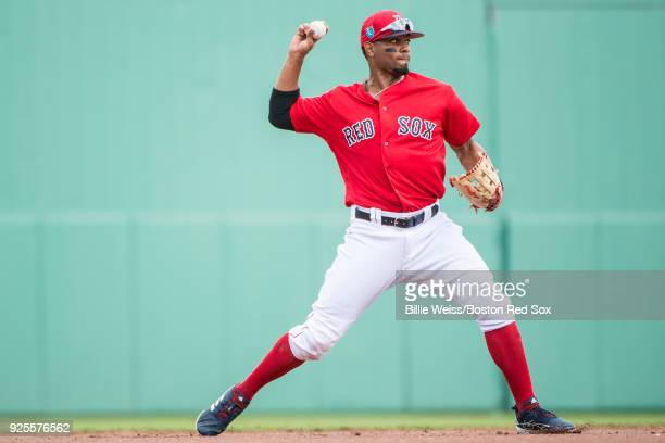 Xander Bogaerts of the Boston Red Sox throws during a game against the Pittsburgh Pirates at JetBlue Park at Fenway South on February 28 2018 in Fort...