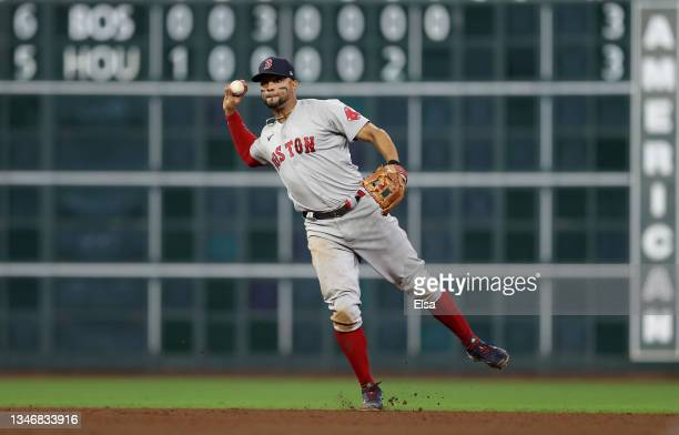 Xander Bogaerts of the Boston Red Sox throws out Alex Bregman of the Houston Astros in the seventh inning during Game One of the American League...