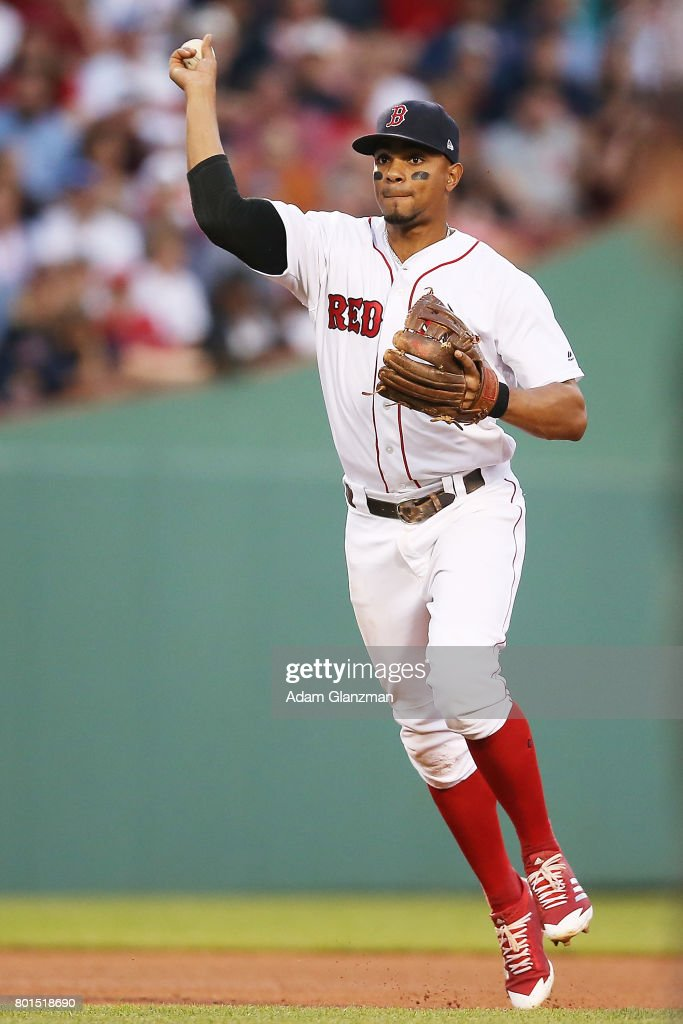 Xander Bogaerts #2 of the Boston Red Sox throws to first base in the fourth inning of a game against the Minnesota Twins at Fenway Park on June 26, 2017 in Boston, Massachusetts.