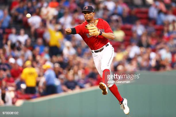 Xander Bogaerts of the Boston Red Sox throws to first base in the fourth inning of a game against the Chicago White Sox at Fenway Park on June 08...