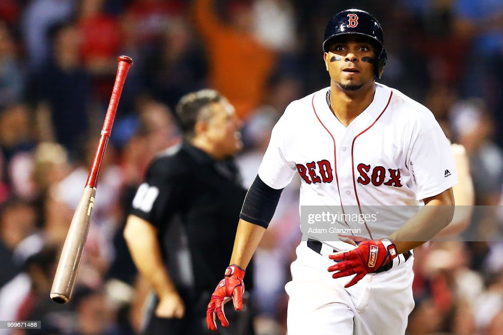 Xander Bogaerts #2 of the Boston Red Sox tosses his bat after hitting a three-run home run in the fifth inning if a game against the Baltimore Orioles at Fenway Park on May 17, 2018 in Boston, Massachusetts.