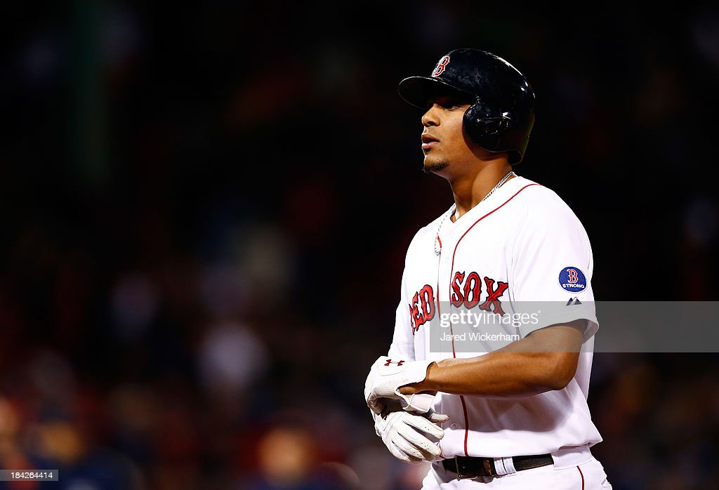 Xander Bogaerts #72 of the Boston Red Sox walks to the dugout after flying out to end Game One of the American League Championship Series against the Detroit Tigers at Fenway Park on October 12, 2013 in Boston, Massachusetts. The Detroit Tigers won 1-0.