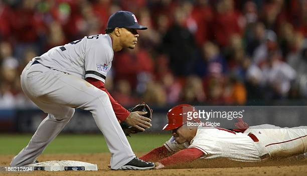 Xander Bogaerts of the Red Sox waits for throw but Kolten Wong of the Cardinals is safe stealing second base in the eighth inning The St Louis...