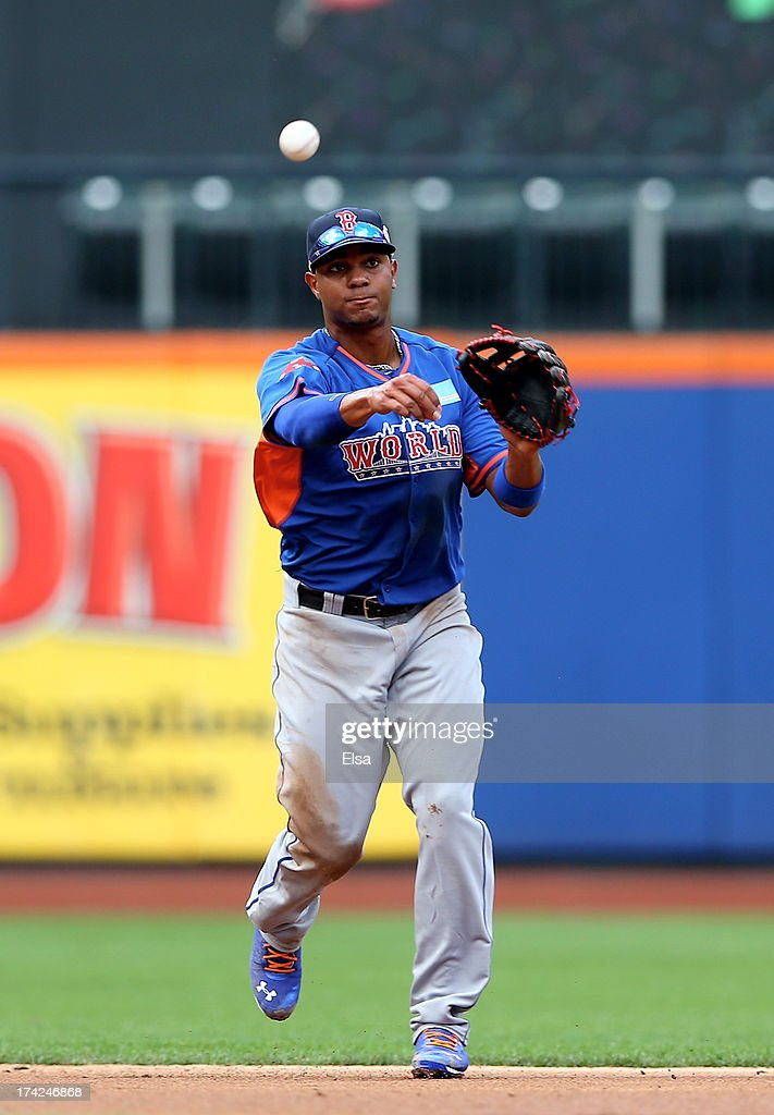 Xander Bogaerts #2 of the World Team sends the ball to first for the out against the United States on July 14, 2013 at Citi Field in the Flushing neighborhood of the Queens borough of New York City. The United States defeated the World Team 4-2.