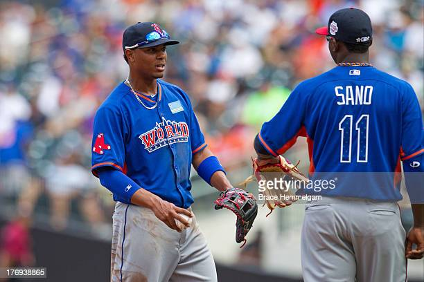 Xander Bogaerts of the World Team talks with Miguel Sano during the game on July 14 2013 at Citi Field in the Flushing neighborhood of the Queens...