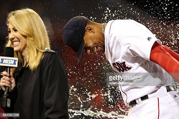 Xander Bogaerts reacts alongside NESN reporter Guerin Austin as water is thrown on him by Christian Vazquez of the Boston Red Sox after their victory...