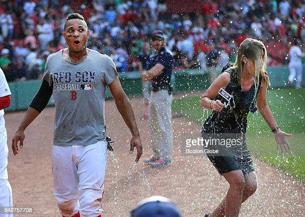 Xander Bogaerts who hit a single to win the game got dowsed with energy drink by Hanley Ramirez as NESN reporter Guerin Austin interviewed him at the...