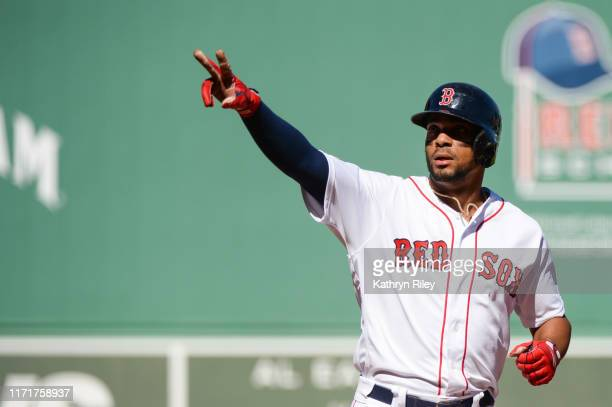 Xander Bogarts of the Boston Red Sox reacts after hitting a tworun home run in the first inning against the Baltimore Orioles at Fenway Park on...