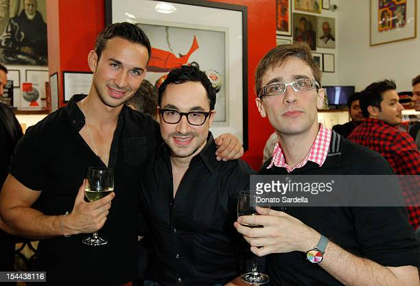 Xander Saide David Brind and Adam Goldman attend Paul Smith Los Angeles hosts Alan Cumming Snaps at Paul Smith on October 19 2012 in Los Angeles...