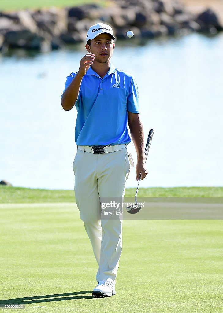 Xander Schauffele catches his golf ball as he leaves the 10th green during preview for the CarerrBuilder Challenge In Partnersihip With The Clinton Foundation at the TPC Stadium Course at PGA West on January 20, 2016 in La Quinta, California.