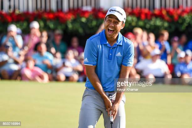 Xander Schauffele celebrates his one stroke victory on the 18th hole green during the final round of the TOUR Championship the last event of the...
