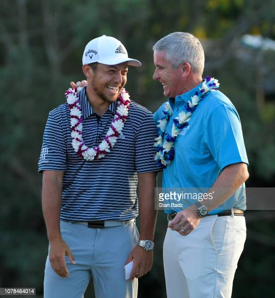Xander Schauffele is congratulated on his win by PGA TOUR Commissioner Jay Monahan after the final round of the Sentry Tournament of Champions on...