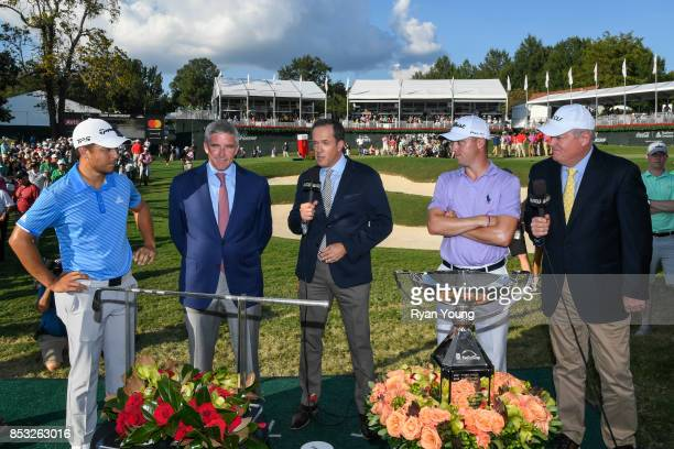 Xander Schauffele Jay Monahan Dan Hicks Justin Thomas and Johnny Miller during the onair trophy presentation following the final round of the TOUR...