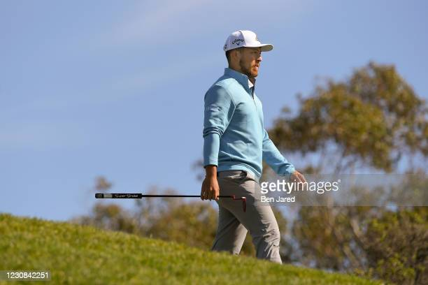 Xander Schauffele leaves the 15th tee on the North course during the first round of the Farmers Insurance Open at Torrey Pines on January 28, 2021 in...
