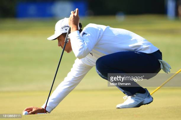 Xander Schauffele lines up a putt on the 14th green during the first round of the Zurich Classic of New Orleans at TPC Louisiana on April 22, 2021 in...