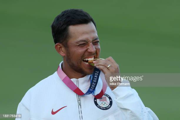 Xander Schauffele of Team United States celebrates with the gold medal during the medal ceremony after the final round of the Men's Individual Stroke...