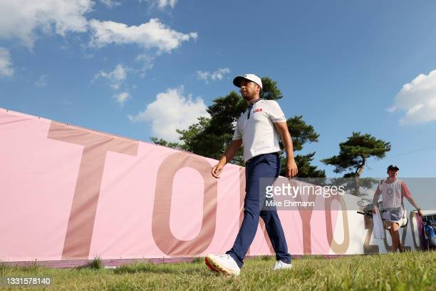 Xander Schauffele of Team United States walks off the 18th hole during the third round of the Men's Individual Stroke Play on day eight of the Tokyo...