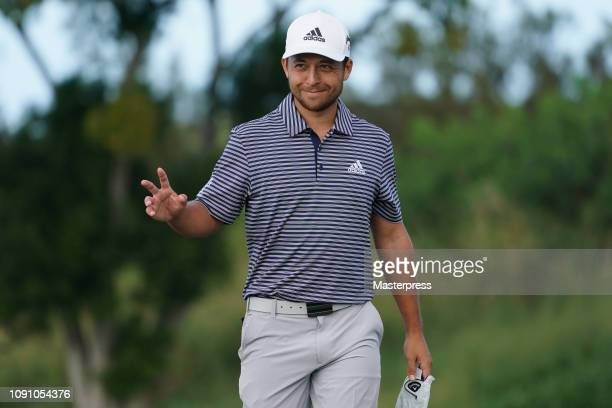 Xander Schauffele of the United States acknowledges after the eagle on the 12th green during the final round of the Sentry Tournament of Champions at...