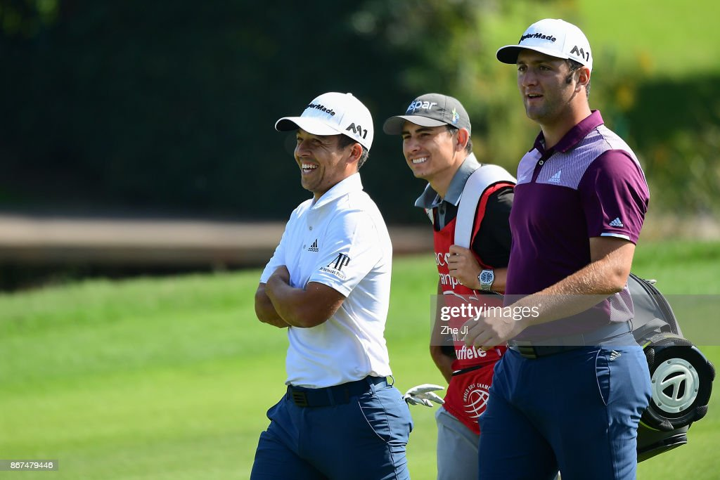 Xander Schauffele (L) of the United States and Jon Rahm (R) of Spain walk on the 18th hole during the first round of the WGC - HSBC Champions at Sheshan International Golf Club on October 28, 2017 in Shanghai, China.