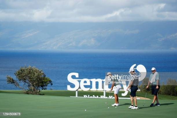 Xander Schauffele of the United States and Patrick Cantlay of the United States putt on the tenth green during a practice round prior to the Sentry...