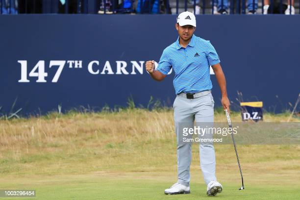 Xander Schauffele of the United States celebrates a birdie on the 18th hole during the third round of the 147th Open Championship at Carnoustie Golf...