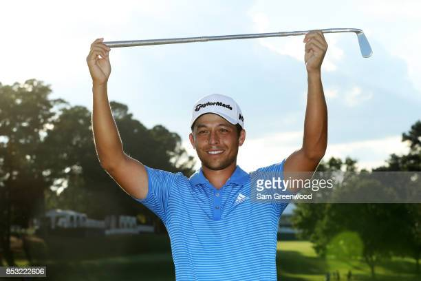 Xander Schauffele of the United States celebrates with the Calamity Jane trophy on the 18th green after winning during the final round of the TOUR...