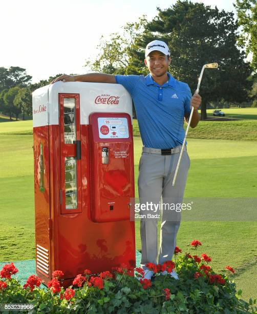 Xander Schauffele of the United States celebrates with the Calamity Jane trophy on the 18th green after winning the final round of the TOUR...