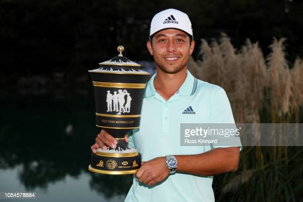 Xander Schauffele of the United States celebrates with the winner's trophy after the final round of the WGC - HSBC Champions at Sheshan International...
