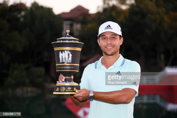 Xander Schauffele of the United States celebrates with the winner's trophy after the final round of the WGC HSBC Champions at Sheshan International...