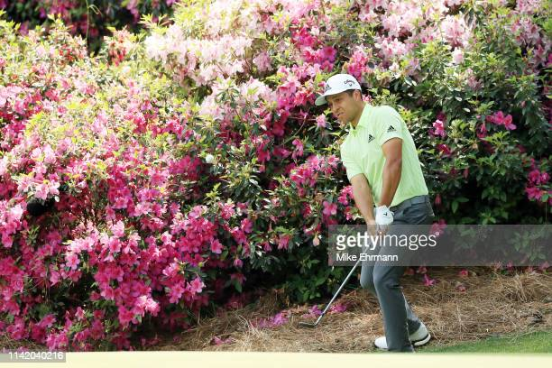 Xander Schauffele of the United States chips to the 13th green during the first round of the Masters at Augusta National Golf Club on April 11, 2019...