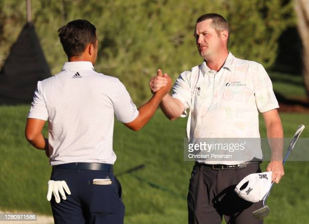 Xander Schauffele of the United States congratulates Jason Kokrak of the United States on the 18th green during the final round of The CJ Cup @...