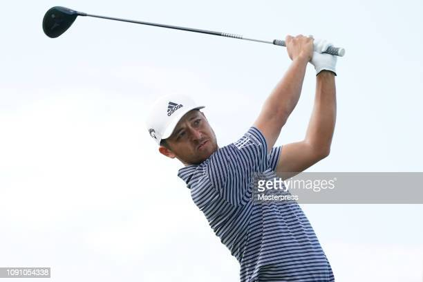 Xander Schauffele of the United States hits a tee shot on the 13th green during the final round of the Sentry Tournament of Champions at the...