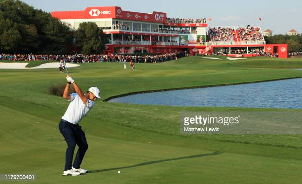 Xander Schauffele of the United States hits his second shot on the 18th hole during Day Four of the WGC HSBC Champions at Sheshan International Golf...