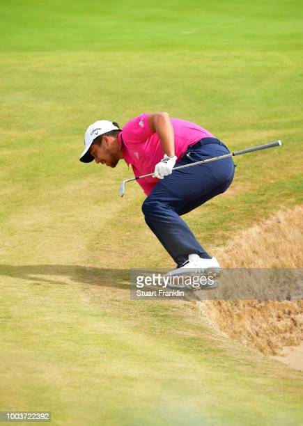 Xander Schauffele of the United States jumps out of a bunker on the fifth hole during the final round of the 147th Open Championship at Carnoustie...