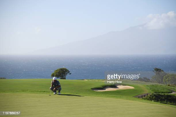 Xander Schauffele of the United States lines up a putt on the 13th green during the final round of the Sentry Tournament Of Champions at the Kapalua...