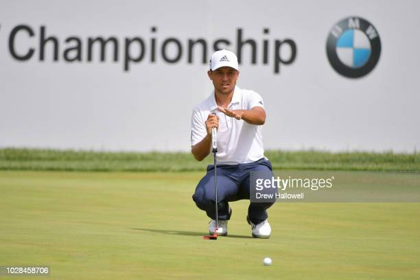 Xander Schauffele of the United States lines up a putt on the 18th green during the second round of the BMW Championship at Aronimink Golf Club on...