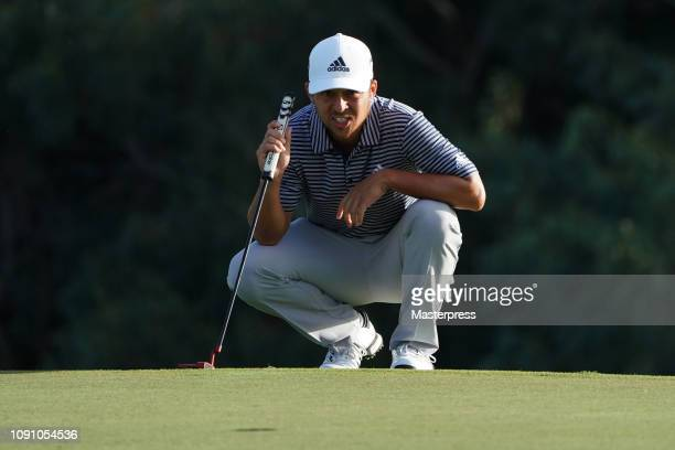 Xander Schauffele of the United States lines up for a putt during the final round of the Sentry Tournament of Champions at the Plantation Course at...
