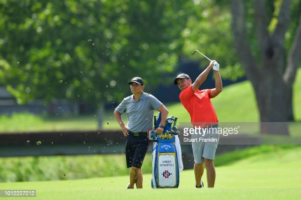 Xander Schauffele of the United States plays a shot during a practice round prior to the 2018 PGA Championship at Bellerive Country Club on August 6...
