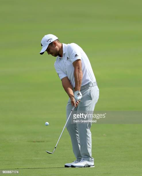 Xander Schauffele of the United States plays a shot during a practice round prior to the Sentry Tournament of Champions at the Plantation Course at...
