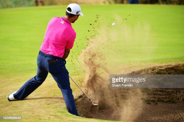 Xander Schauffele of the United States plays a shot from a bunker on the 11th hole during the final round of the 147th Open Championship at...