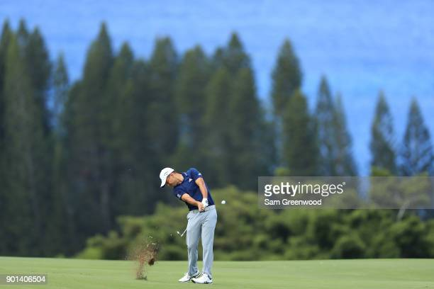 Xander Schauffele of the United States plays a shot on the fourth hole during the first round of the Sentry Tournament of Champions at Plantation...