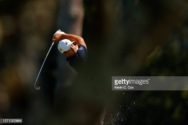 Xander Schauffele of the United States plays a shot on the ninth hole during the final round of the TOUR Championship at East Lake Golf Club on...