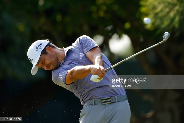 Xander Schauffele of the United States plays his shot from the 11th tee during the third round of the TOUR Championship at East Lake Golf Club on...