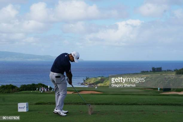 Xander Schauffele of the United States plays his shot from the 11th tee during the first round of the Sentry Tournament of Champions at Plantation...