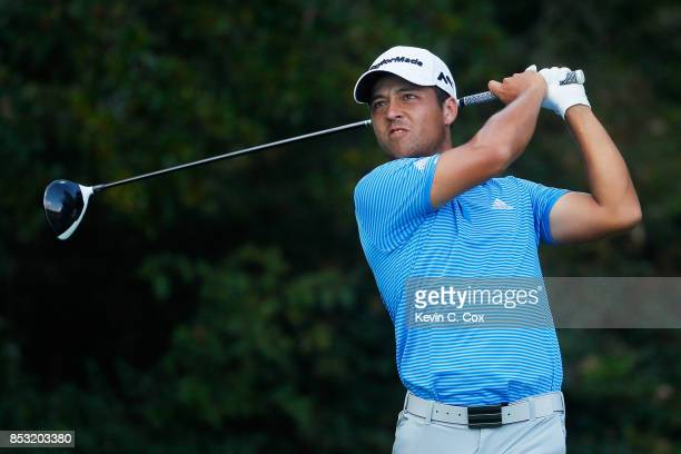 Xander Schauffele of the United States plays his shot from the 13th tee during the final round of the TOUR Championship at East Lake Golf Club on...