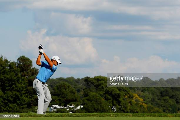 Xander Schauffele of the United States plays his shot from the 14th tee during the final round of the TOUR Championship at East Lake Golf Club on...