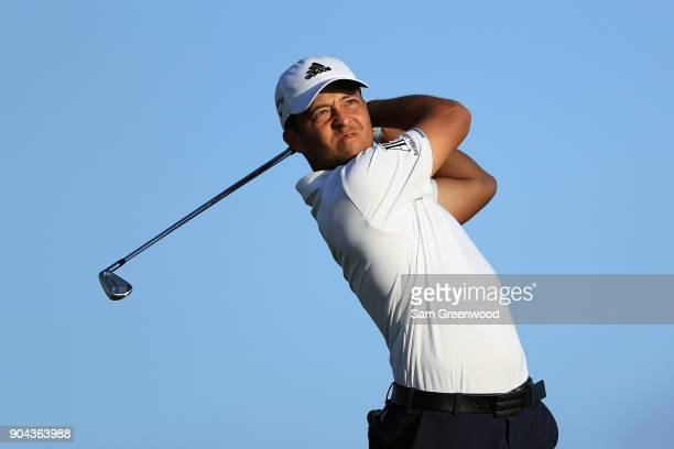 Xander Schauffele of the United States plays his shot from the 17th tee during round two of the Sony Open In Hawaii at Waialae Country Club on...